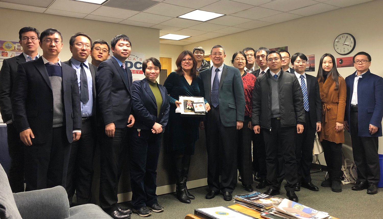 The visiting Chinese delegation included 15 officials and professionals from China's State Administration for Market Regulations, along with Regional Director Lilian Mauro (center).